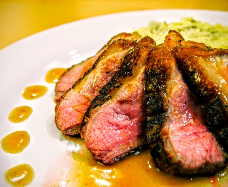 The Four Seasons Crisp Duck With Orange Sauce And Fig Garnish